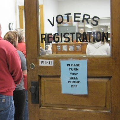 People line up to cast a ballot at the Voter Registration