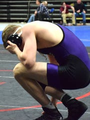 Waynesboro's Roger Graham kneels on the mat after winning the third-place bout at 160 pounds at the VHSL Group 3A wrestling championships on Saturday, Feb. 18, 2017, at the Salem Civic Center in Salem, Va.