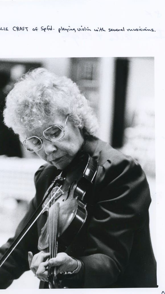 Julie Craft of Springfield playing violin with several
