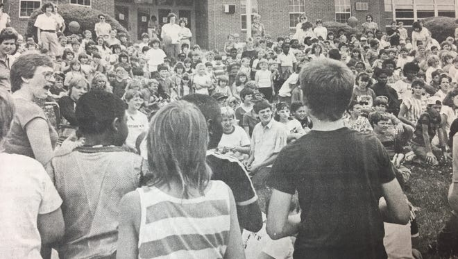 Morganfield Elementary students joined in the Just Say No campaign with a rally in May 1987. Shown here, teacher Cindy Hollowell, left, leads her class in a Just Say No song.