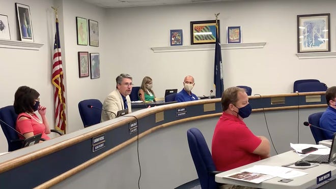 Aiken County Superintendent King Laurence, right of U.S. flag, praised the success of the first week back to school while acknowledging some problems with their virtual model that need to be fixed during a school board meeting Tuesday, Sept. 8.