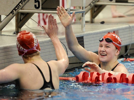 Fishers swimmer Lauryn Parrish, right, sits about seven-tenths of a second behind  Carmel's Kelly Pash in both the 100 and 200 freestyle — clocking :50.49 and 1:48.92, respectively, as personal bests.