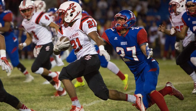 Palm Springs running back  Kelton Johnson avoids being tackled during a kickoff return.