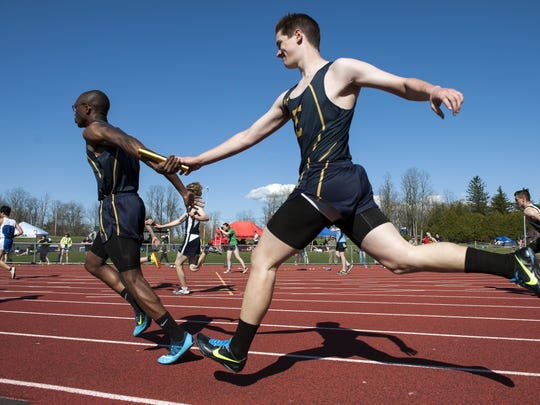 Two members of the Essex High School boys track and