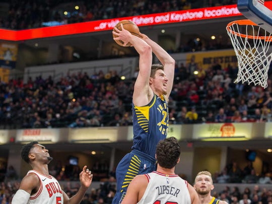 Pacers forward T.J. Leaf (22) goes to slam dunk the