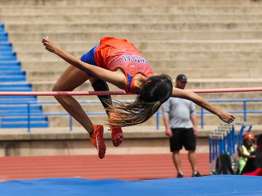 Central Yasmine Contreras clears the high jump during