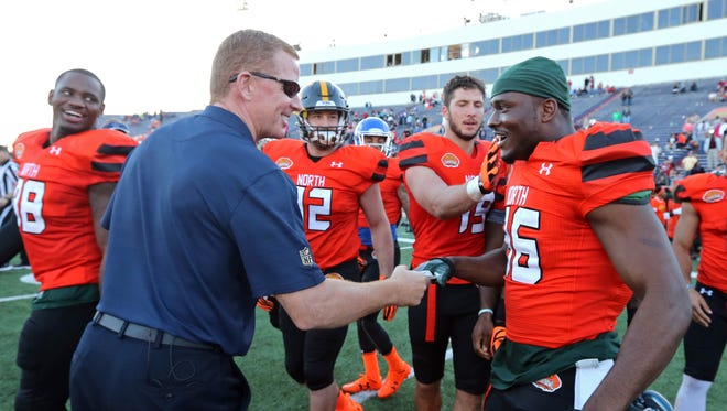 Jan 30, 2016; Mobile, AL, USA; North squad head coach Jason Garrett of the Dallas Cowboys shakes hands with North squad wide receiver Aaron Burbridge of Michigan State (86) after his touchdown catch on the last play of the game of the Senior Bowl at Ladd-Peebles Stadium.
