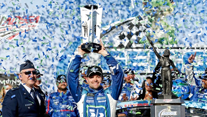 Ricky Stenhouse Jr. celebrates after winning the GEICO 500 Sunday at Talladega Superspeedway.