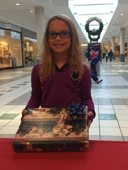 Cassidy Werkheiser, 8, of Quinton, stopped by The Daily