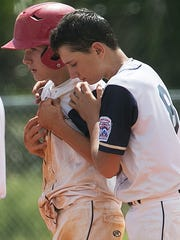 South Fort Myers' Preston Heben, right, comforts Mike McAloose after McAloose was picked off at second base for the final out. The South Fort Myers Little League Junior baseball team lost  4-2 to the Rutherfordton, North Carolina baseball team at the South East Regional Championship game at Sam Fleishman Regional Sports Conplex. The Rutherfordton came from a 2-0 deficit.