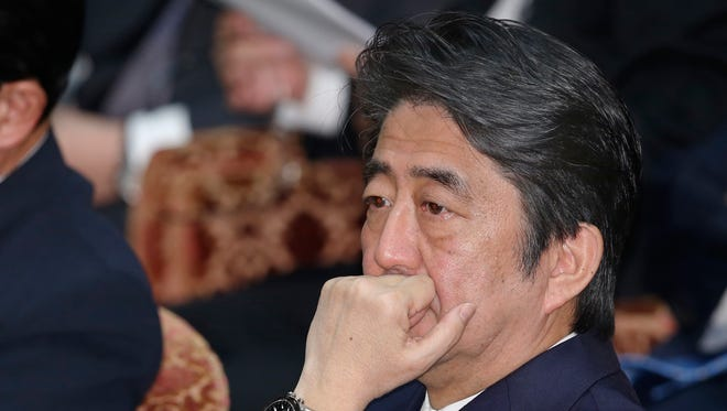 Japan's Prime Minister Shinzo Abe attends a lower house budget committee session at Parliament in Tokyo Thursday, Jan. 29, 2015. Japan was studying the latest message purportedly from the Islamic State group, which extends the deadline for Jordan's release of an Iraqi prisoner, while officials worked feverishly Thursday to try to free a Japanese journalist held by the militant group.