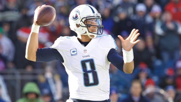 Tennessee Titans rookie quarterback Marcus Mariota passed for 2,818 yards and 19 touchdowns this season.