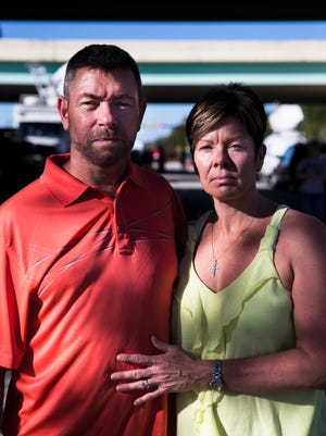 "Lisa and David Mizen outside of Marjory Stoneman Douglas High School on Friday, Feb. 16, 2018. Their son Lewis, 17, was on lockdown, hiding in a closet, at the high school on Wednesday afternoon. After seeing police rush to the school and checking a local message board website that posted about an active shooter situation, Lisa texted her son. ""I texted him and said this is real,"" recalled Linda, who said her son wasn't sure if it was a drill or not. ""The difficulty then was we're at home watching it live and we know there's an active shooter on campus. We knew he was in a closet, but we couldn't get ahold of him,"" recalled David. ""We couldn't breathe. It's suffocating not being able to do anything."" Lisa added, ""I mean it's awful because here we are 3 days later and I actually feel guilty because I keep crying. I keep crying for no reason and our son's home."""