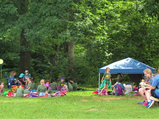 Girl Scouts gathered with counselors at unit sites
