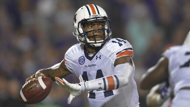 Auburn quarterback Nick Marshall passes during the Tigers' 20-14 victory over Kansas State.