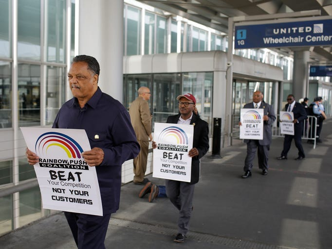 Reverend Jesse Jackson (C) stages a protest against