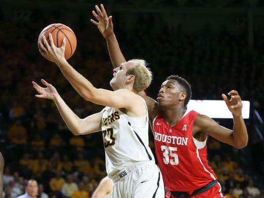 Wichita State guard Conner Frankamp goes to the basket against Houston forward Fabian White Jr. during the first half of an NCAA college basketball game in Wichita, Kan., Thursday, Jan. 4, 2018. (Travis Heying/The Wichita Eagle via AP)