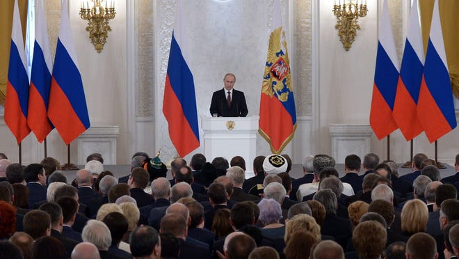 Russian President Vladimir Putin addresses a joint session of Russian parliament in Moscow on March 18.