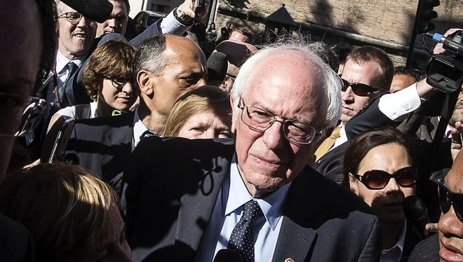 """Bernie Sanders meets reporters outside the Perugino gate at the Vatican on April 15, 2016. Sanders spoke at a conference commemorating the 25th anniversary of """"Centesimus Annus,"""" a high-level teaching document by Pope John Paul II on the economy and social justice at the end of the Cold War."""