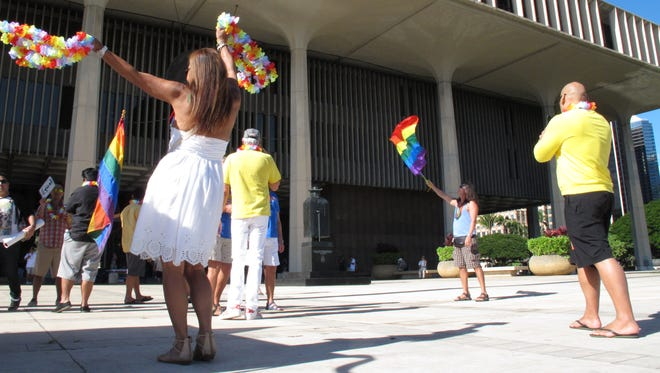 Gay marriage supporters rally outside the Hawaii Capitol in Honolulu ahead of a Senate vote on whether to legalize same-sex marriage on Nov. 12, 2013.