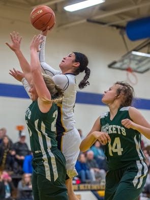 Greencastle's Jenay Falukner takes a shot while being