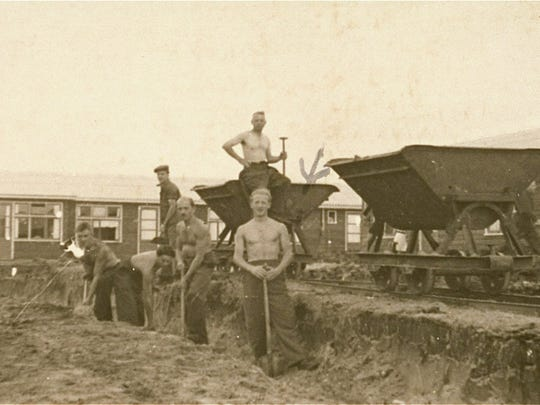 A group of Jewish inmates works at a construction site in the Westerbork transit camp. Kurt Majerowicz is pictured in the front.The Citizen-Times has a single use agreement with the United States Holocaust Memorial Museum for this photo.
