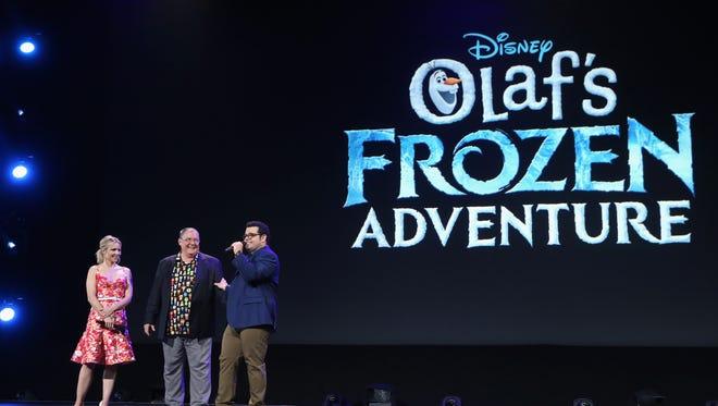 Kristen Bell of Olaf's Frozen Adventure, Chief Creative Officer of Pixar and Walt Disney Animation Studios John Lasseter, and Josh Gad took part in the Walt Disney Studios live action/animation presentation at Disney's D23 expo July 14.