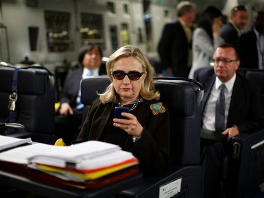 Then-Secretary of State Hillary Rodham Clinton checks her Blackberry from a desk inside a C17 military plane in 2011 upon her departure from Malta,  bound for Tripoli, Libya. Clinton used a personal e-mail account during her time as secretary of state, rather than a government-issued email address, potentially hindering efforts to archive official government documents as required by law. Clinton's office said nothing was illegal or improper about her use of the non-government account and that she believed her business e-mails to State Department and other .gov accounts would be archived in accordance with government rules.