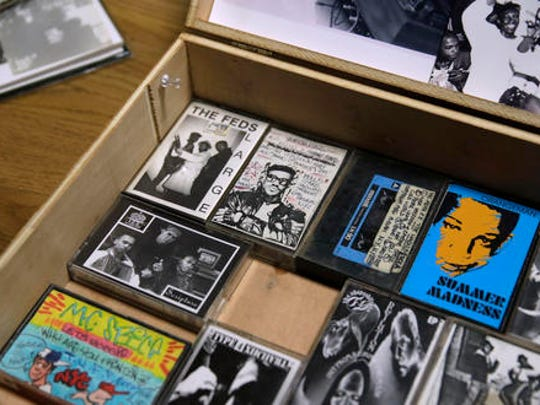 A collection of hip-hop cassette tapes and memorabilia from the 1980's are displayed at the Boston campus of the University of Massachusetts in Boston, Thursday, Nov. 17, 2016. Thanks to UMass, the world will soon have access to 300 unreleased demo tapes from the early days of Boston hip-hop. The university paired with Boston Public Library to form a new hip-hop archive that's the latest example of colleges treating hip-hop as a scholarly subject.