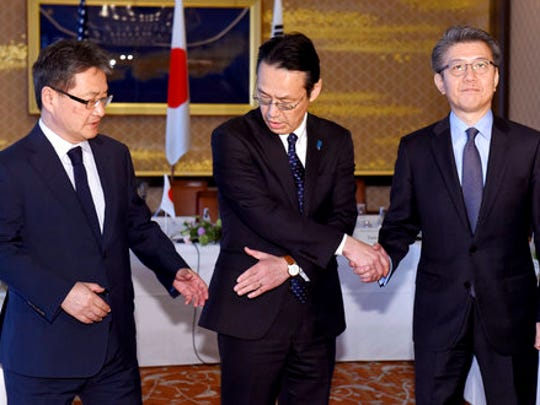 Chief nuclear negotiators from left to right, Joseph Yun, U.S. special representative for North Korea policy,  Kenji Kanasugi, director general of the Japanese Foreign Ministry's Asian and Oceanian Affairs Bureau, and Kim Hong-kyun, special representative for Korean Peninsula peace and security affairs at the South Korean Foreign Ministry, join hands before their meeting about North Korean issues at the Iikura Guesthouse in Tokyo Tuesday, April 25, 2017. North Korea marks the founding anniversary of its military on Tuesday, and South Korea and its allies are bracing for the possibility that it could conduct another nuclear test or launch an intercontinental ballistic missile for the first time.