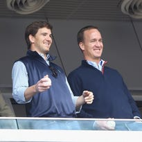 Peyton and Eli Manning stress importance of family at Sacred Heart