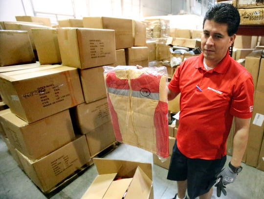 Mario Romero of Mattress Firm shows one of the 20,000