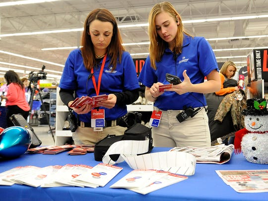 Shanna Nelson, left, and Katie Radcliff go through pull tickets during Black Friday at Academy Sports + Outdoors in Jackson, Tenn., on Nov. 25, 2016.