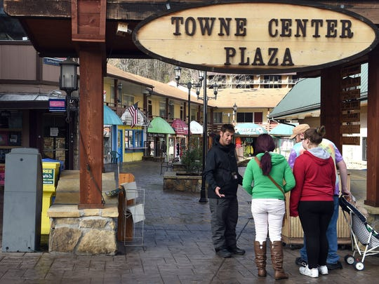 Timeshare salesman Derrick Winslow talks with visitors on the Gatlinburg Parkway on Dec. 12.
