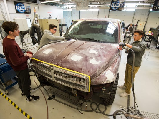 Auto body students at Polytech High School work on