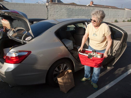 Judy Lucas unloads some household items from her car