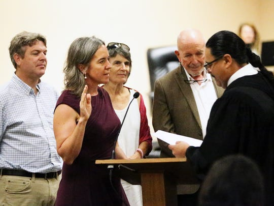 EPISD trustee Susie Byrd was sworn into office by 205th District Court Judge Francisco X. Dominguez. Standing with her is her husband, Edward Holland, left, and parents Lee and Bobby Byrd. Other trustees had been previously sworn in. Byrd pushed for a district letter opposing Texas' so-called bathroom bill.
