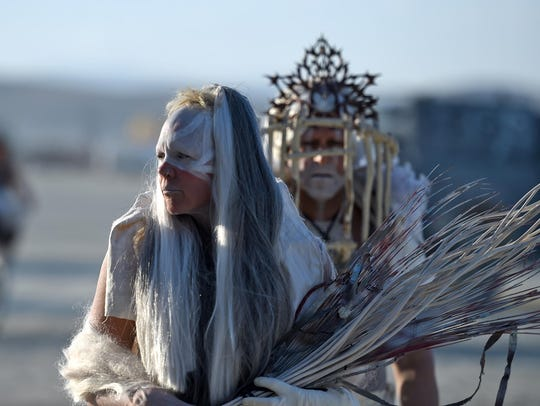 Burning Man 2017.  A couple dressed in costume walks