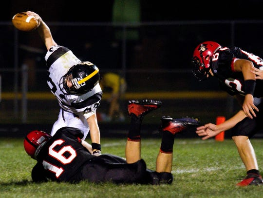 Pewaukee senior T.J. Watt (16) takes down Brown Deer