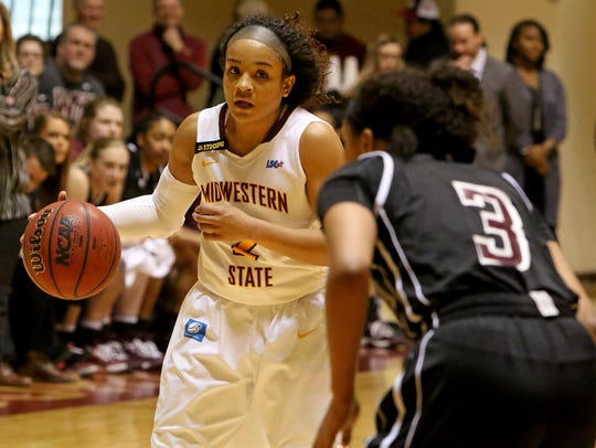 Midwestern State's Jasmine Richardson dribbles in the