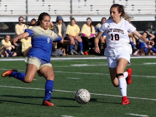 Boswell's Kayla Marquez kicks the ball away from Wichita