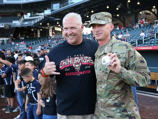 UTEP head football coach Dana Dimel and Sgt. Terry Cavey from Fort Bliss were among the guest who threw out a ceremonial pitch Monday at Southwest University Park.
