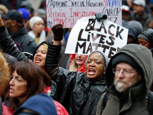 Protesters march on Michigan Avenue on Nov. 27, 2015,