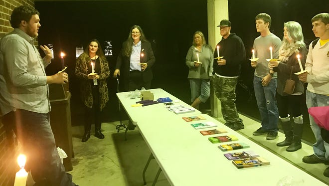 A small group held a vigil at Ohio University - Chillicothe to recognize Suicide Prevention Awareness Month Thursday night.