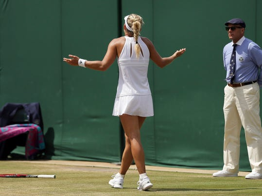 Germany's Angelique Kerber reacts after missing a shot as she plays Spain's Garbine Muguruza during their Women's Singles Match on day seven at the Wimbledon Tennis Championships in London Monday, July 10, 2017. (AP Photo/Tim Ireland)