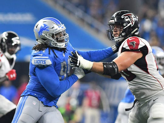 Ziggy Ansah, left, led the Lions with 12 sacks in 2017.