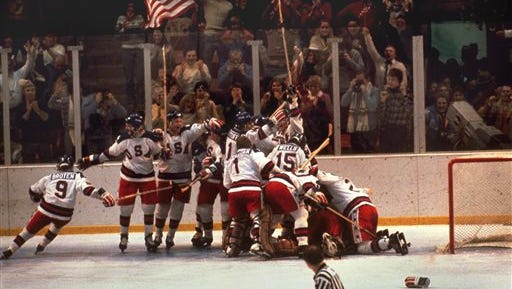 FILE -In this Feb. 22, 1980 file photo, the U.S. hockey team pounces on goalie Jim Craig after a 4-3 victory against the Soviets in the 1980 Olympics, as a flag waves from the partisan Lake Placid, N.Y. crowd. It's been more than three decades since his landmark goal became the centerpiece of the U.S. Olympic hockey team's Miracle on Ice. For 60-year-old Mike Eruzione, it still seems like only yesterday. (AP Photo, File)