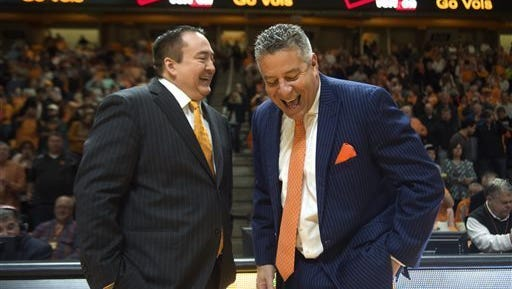 Donnie Tyndall, here with Auburn coach Bruce Pearl, has been fired by Tennessee where Pearl coached before he was fired after committing NCAA violations. Tyndall has been let go because he's expected to have committed NCAA violations.