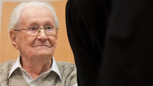 Oskar Groening, 93, sits in the dock of the court in Lueneburg, Germany, on  Tuesday, April 21, 2015. The  former Auschwitz guard is on trial on 300,000 counts of accessory to murder, in a case that will test the argument that anyone who served at a Nazi death camp was complicit in what happened there.