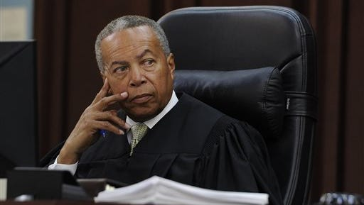 Criminal Court Judge Monte Watkins listens to a witness during a hearing in a case involving two former Vanderbilt football players in court Monday, June 15, 2015, in Nashville, Tenn. Defense attorneys for the two former Vanderbilt football players convicted in the dorm-room rape of a student asked a judge Monday to declare a mistrial, saying a juror intentionally withheld information that he was a rape victim during the jury selection process. (Shelley Mays/The Tennessean via AP) NO SALES